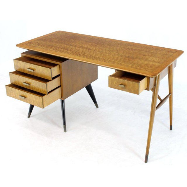 Mid-Century Modern blond wood tiger maple and birch wood combination kneewhole desk. Exposed sculptural tapered legs Ico...