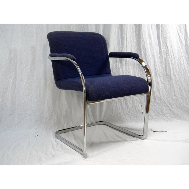 Vintage modern and all original chrome frame chair. Great purple fabric. Comfortable , cantilevered seating. No maker's...