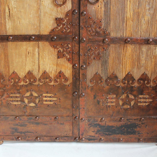 Antique elm door from Northern China. The panels feature original iron work  detail, a - Antique Chinese Elm Door Chairish