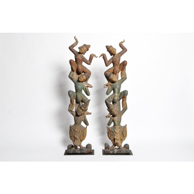 These handsome hand-carved Thai dancers are from Chiang Mai, Thailand, circa late 20th century. Carved from teak wood they...
