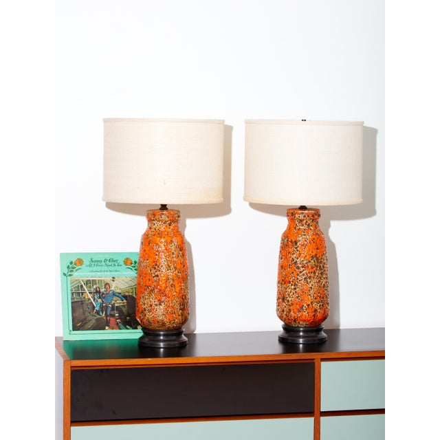 Pair of vintage ceramic lamps in uniquely textured orange glaze.