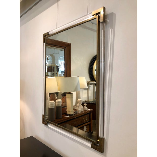 """Mid Century Modern lucite mirror with brass inner frame and corner detail. Italy, circa 1970's. Size: 31.75"""" W 39.75"""" H"""