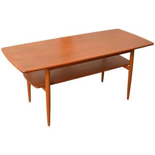 Mid-Century Modern Swedish Teak Coffee Table With Shelf For Sale