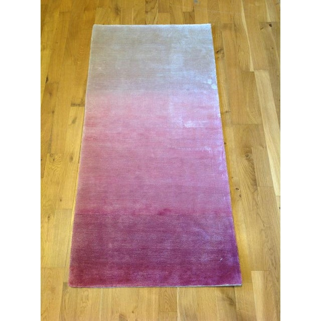 An ombre style rug featuring white, pink, and purple. Made from wool and art silk making it super silky soft to the touch....