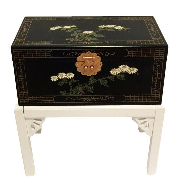 Small, Chinoiserie-style, black lacquered decorative chest with white flowers and gold details. Base and fretwork have...