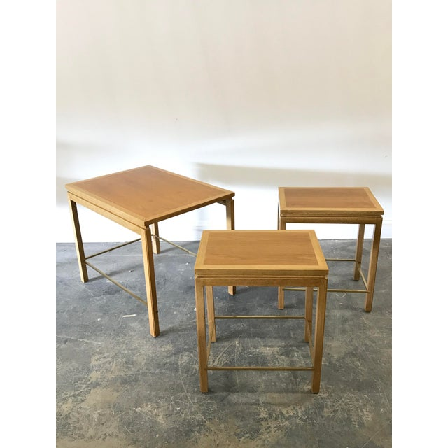 Beautiful set of three nesting tables designed by Edward Wormley for Dunbar. Tables features a mahogany structure and...