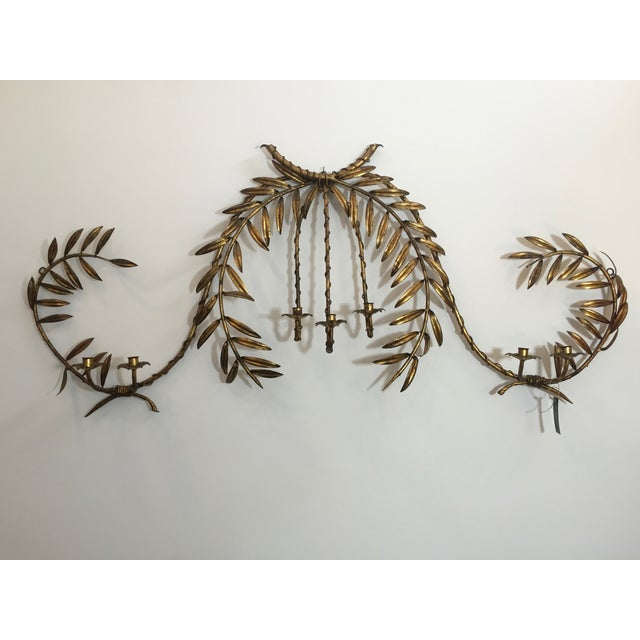 c. 1960's Italian olive branch wall light/sconce with 7 candle holders. The gilt has a nice patina and some leaves are...