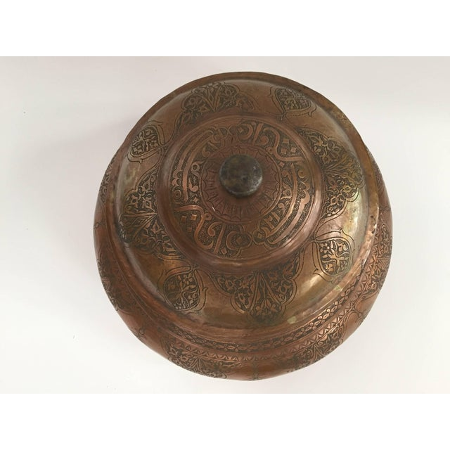 Large Middle Eastern Persian Mameluke style tinned copper jar with lid. Heavily hand-hammered and chased with Kufic...