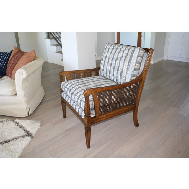 This beautiful vintage caned chair has been newly upholstered in a geometric designer fabric.