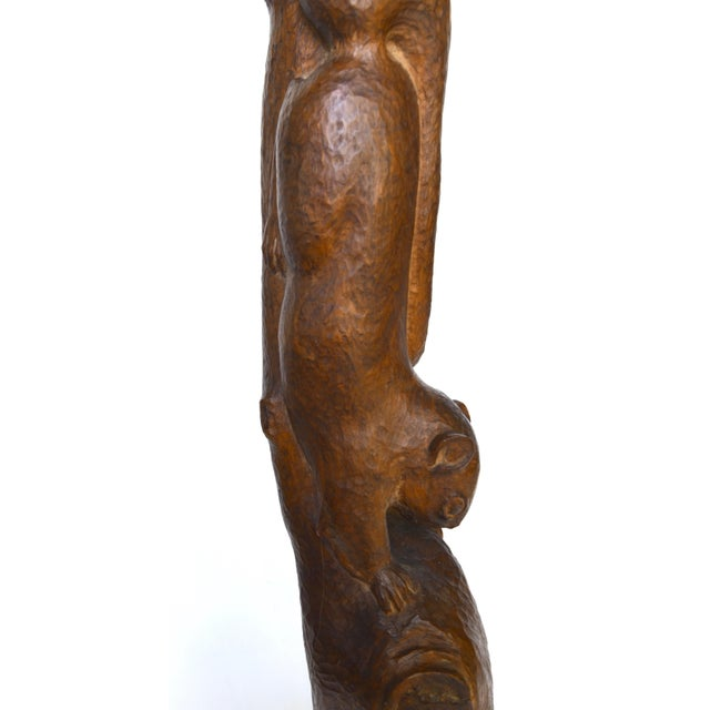 A gorgeous early 1900s American Folk Art hand carved squirrel on tree branch with wonderful movement and details, rich...