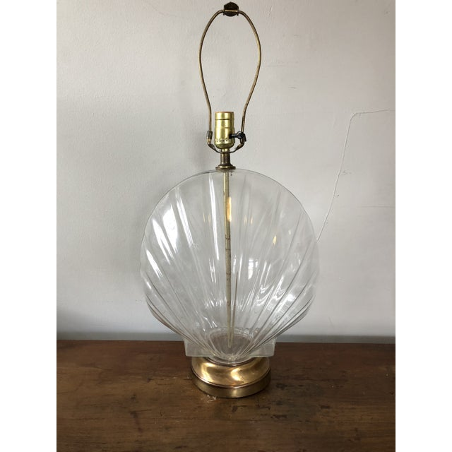"""1970's glass seashell form lamps on brass bases. Some wear present on the bases, no finials included. Measures 18.5"""" to..."""