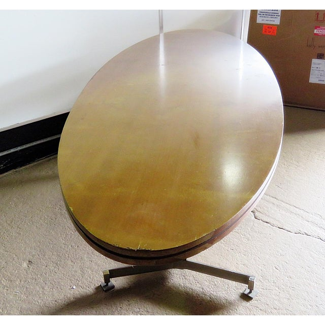 Italian techno style dining table on a metal base. Made in the late 20th century.