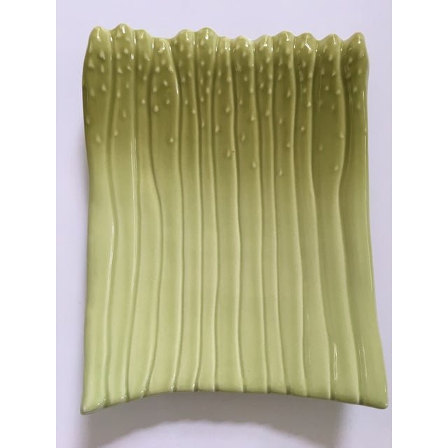 Offering a lovely green, curved, heavy ceramic platter made up of long asparagus shaped spears(13 to be exact). This piece...