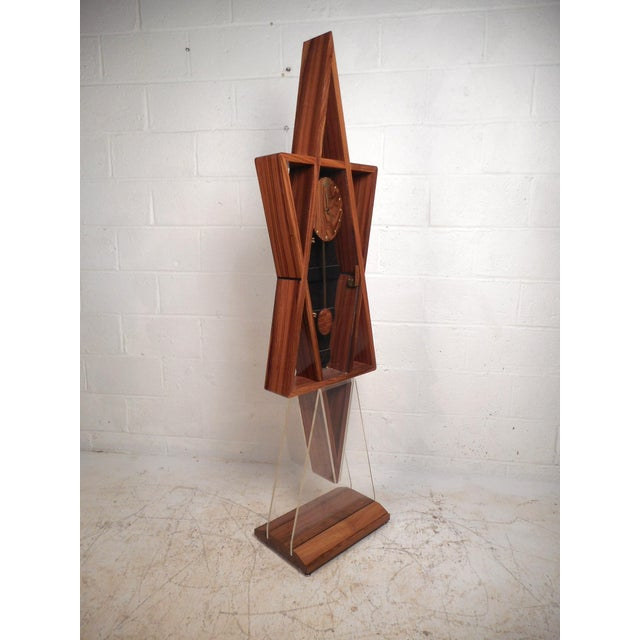 This beautiful midcentury floor clock features a unique wood front pendulum and clock. The unusual design has a...