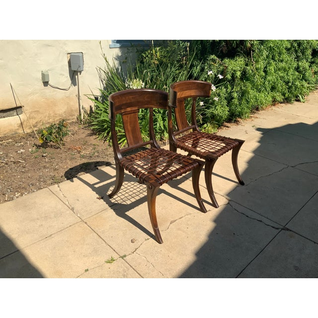 Klismos modern walnut chairs, set of 2. Chairs are made of solid walnut and have a natural walnut finish. Chairs are in...