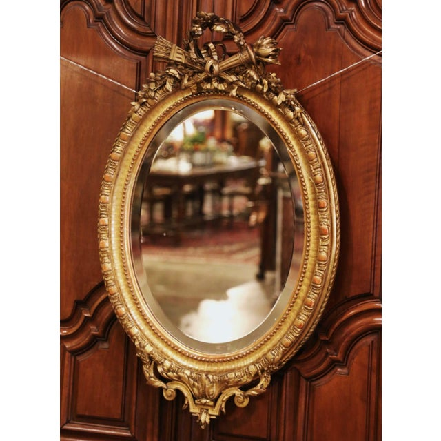 Decorate a powder room or entryway with this elegant antique wall mirror. Crafted in France, circa 1860, the beaded oval...