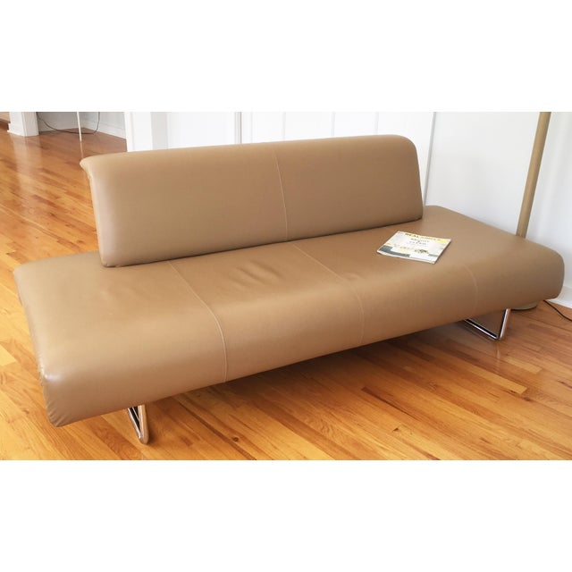 We fell in love with the minimalism of this sofa. Would love looking at it the rest of our lives, but our scaled down...