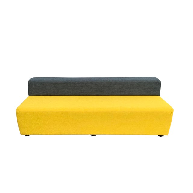 Beautiful Knoll armless sofa. Deep charcoal gray back, with a soft yellow seat. Hidden bun feet on the bottom....