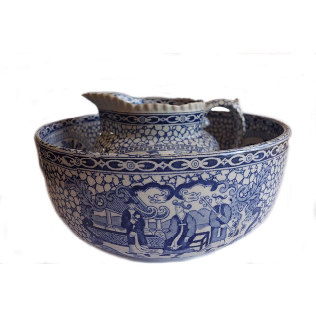 This is a beautiful example of early blue and white chinoiserie. The jug has two different scenes. One side depicts Three...