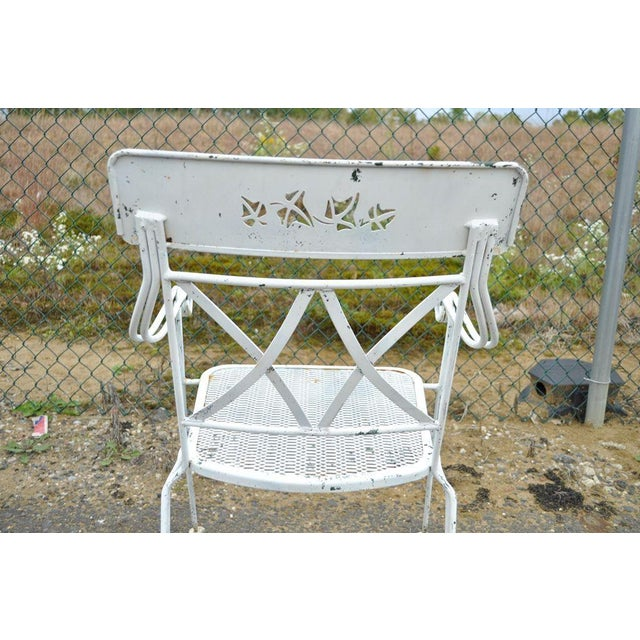 Unique Vintage Hollywood Regency White Wrought Iron Outdoor Dining Set in the Style of Salterini. The set consists of a...