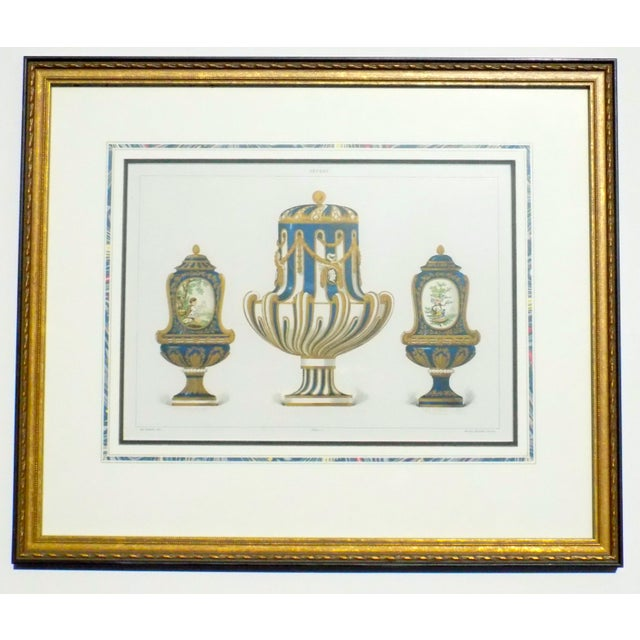 Pair of framed prints depicting fine porcelains, French matting. Original chromolithograph prints heightened by hand with...