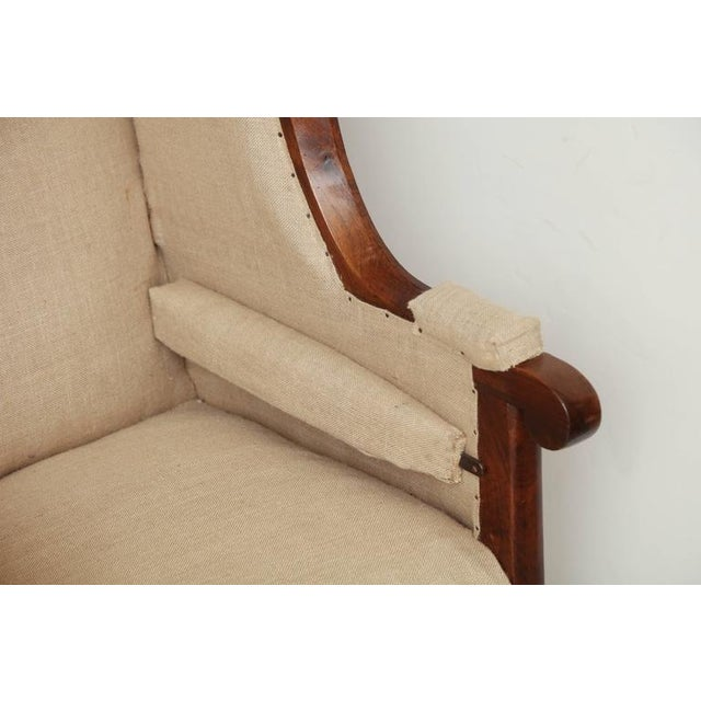 Early 19th Century French Walnut Upholstered Wing Chair For Sale - Image 4 of 10