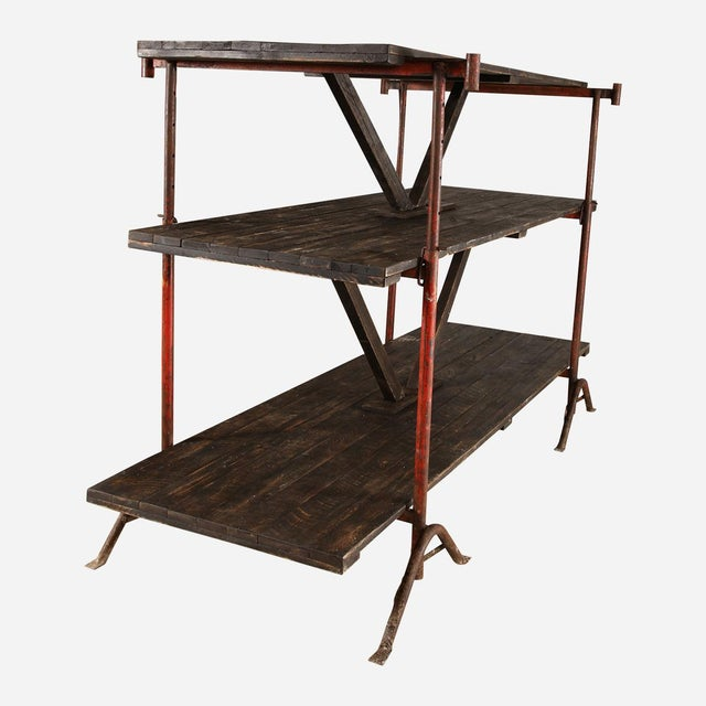 Industrial shelving rack from Factory in Belgium. Wood shelf and iron supports.