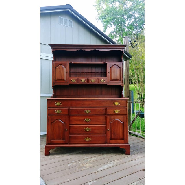 Item offered is a quality made solid Black Cherry Traditional sideboard/china hutch by Frederick Duckloe Bros. PA. It has...