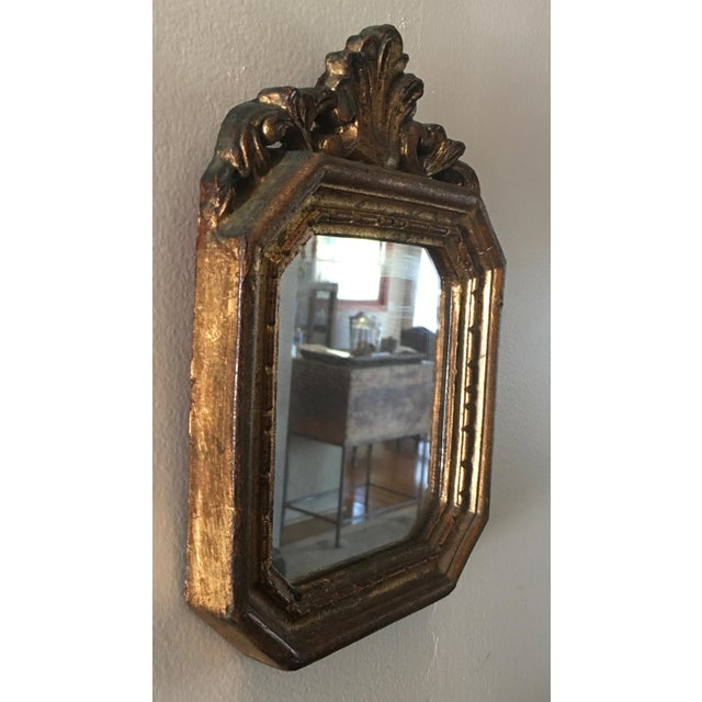 Nice small decorative gilt mirror. Great for placement anywhere, hook on back for hanging . Also felted back to keep from...