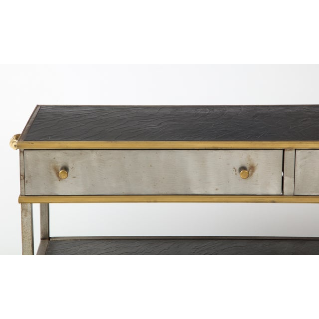 A great looking console designed in the manner of Maison Janson. This chid piece in steel and brass can serve as a...