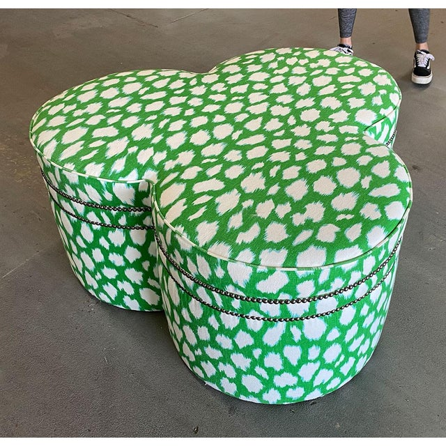 Brilliant green patterned Kate Spade fabric covers this clover-leaf form ottoman. Custom made. Trimmed in silver nail...