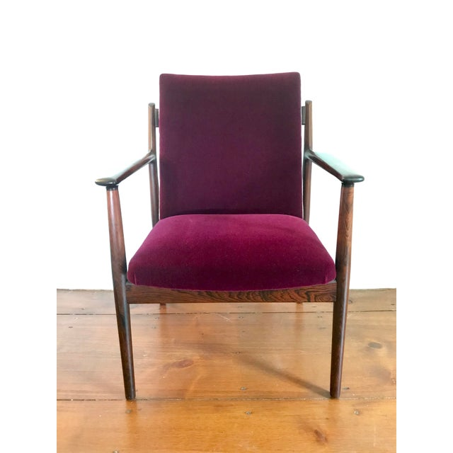 Arne Vodder solid Rosewood Arm chair Model 431. Manufactured by Sibast Furniture circa 1965 with a markers label under...