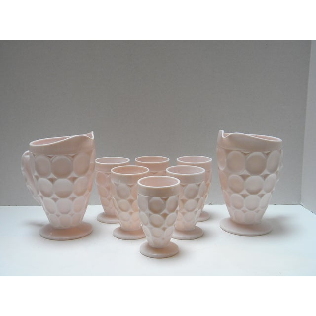 """Lovely, vintage """"Shell-Pink"""", thumbprint ware. Set of 2 pitchers and 6 juice cups. Each cup measures 4.5""""T."""