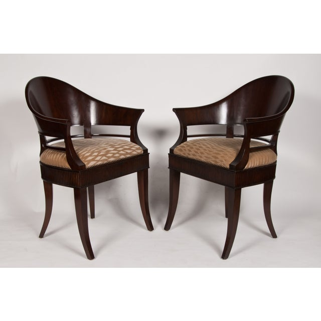 A great hand made pair of solid Mazzard (French Mahogany) chairs designed by L.A. designer, James Jennings in the 90's....