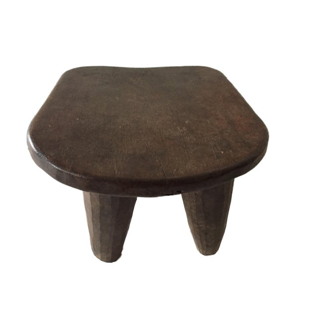 Superb African Senufo milk stool on four tapered legs with an abstract form . Carved from one piece of wood. Senufo...