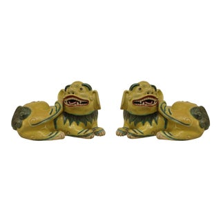 Asian Chinese Green and Yellow Small Porcelain Reclining Foo Dog Figures- A Pair For Sale