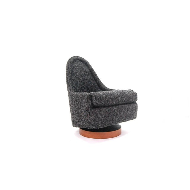Petite chair designed by Milo Baughman for Thayer Coggin, circa 1966. Chair sits on a circular walnut veneer base, and...
