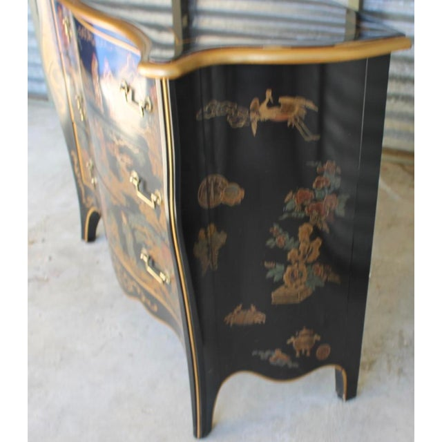 Vintage chinoiserie black lacquer chest of drawers by Drexel from Et Cetera collection. This piece features painted Asian...