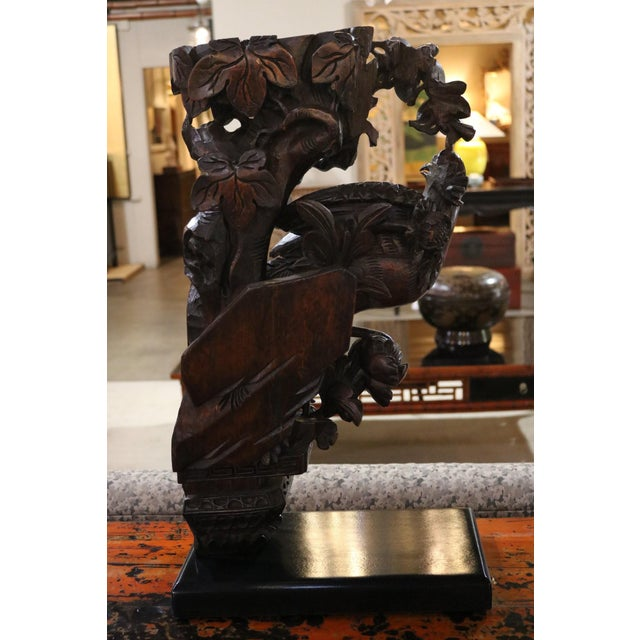 Carved Wooden Pheasant with Ebonized Mahogany Base from China. Original fragment from door frame of house.