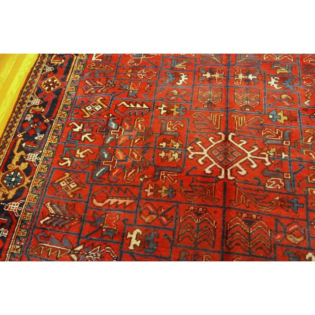 Antique handmade Heriz rug in red wool with all-over design. The rug made in the beginning of 20th century. -condition:...