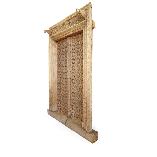 Beautiful antique Raja Indian doors. Exquisite hand carved details with intricate flower medallion patterns. Bronze and...