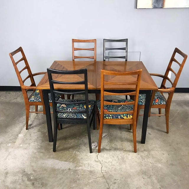 Newly refinished mid century modern dining set by Stanley Furniture. The cool ladder back chairs have all new upholstery...