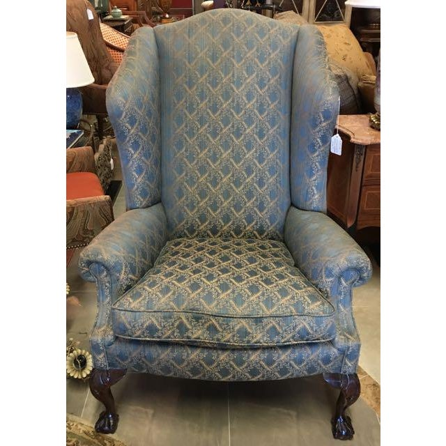 George Smith Ltd. Low Scroll Arm Wing Chair. Very handsome and dignified chair with hand carved ball-and-claw feet, broad...