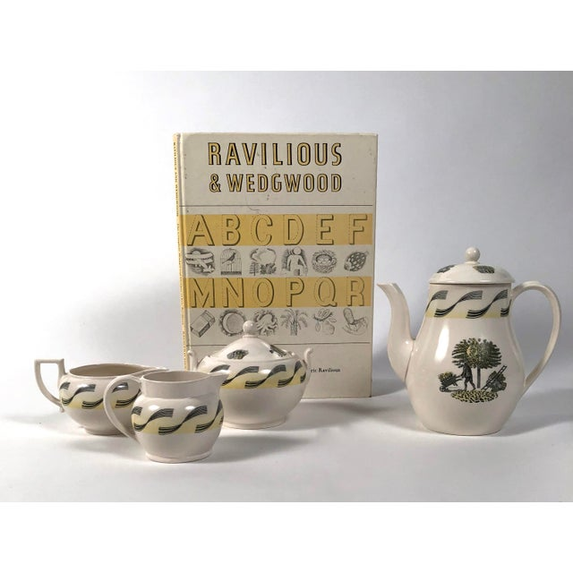 An original Eric Ravilious designed 4 piece coffee service for Wedgwood from the Garden Series, designed circa 1938 and...