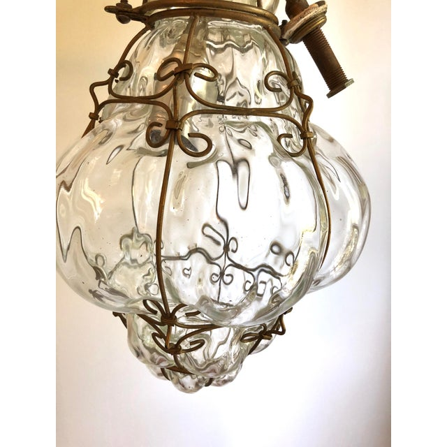 Vintage Caged Clear Murano Glass Lantern Pendant. Wired and in working. Ceiling cap included. Minimum hanging height is...