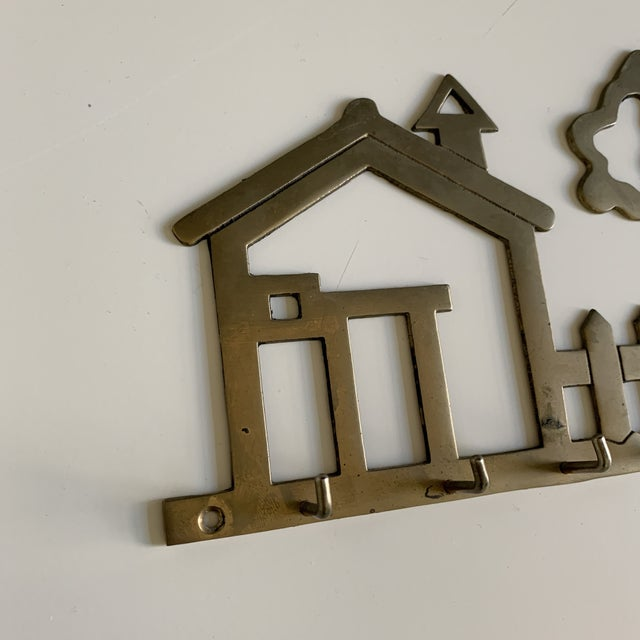 Darling house brass hook, perfect for keys.