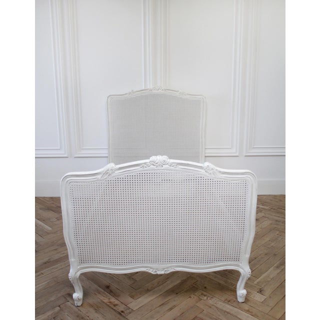 Reproduction Twin Carved and Painted Louis XV Style French Bed with Cane SKU Number: LU1822315333832 Description:...