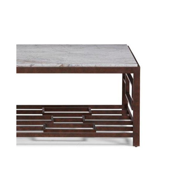 The Marcos Coffee Table This handsome metal cocktail table is all welded construction finished in a rich bronze hue. The...