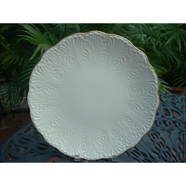 Classic Lenox white with gold rim. Traditional Lenox leaf and fan pattern; gold Made in USA logo on bottom; perfect...
