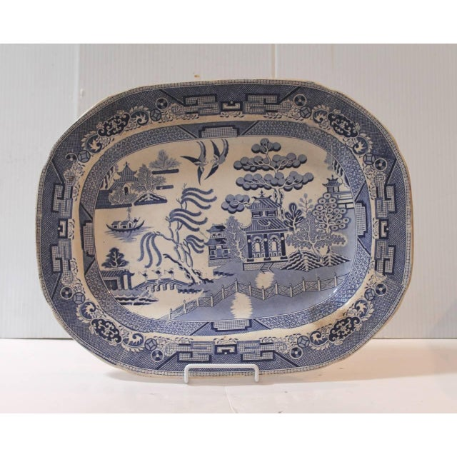 19th century blue and white Staffordshire England ironstone serving platter. This fine example of early blue willow is...